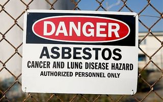 Asbestos is in the air sign